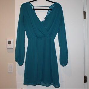 Low cut long sleeve short dress